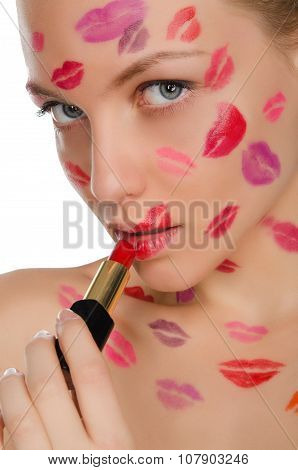 Beautiful Woman With Kisses On Face In Lipstick And Lips