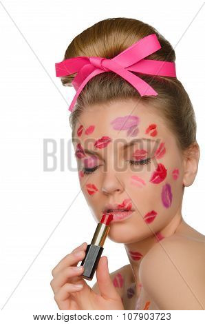 Beautiful Woman With Kisses On Face And Lipstick
