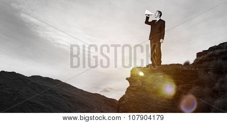 Businessman Shouting Megaphone Top Mountain Concept