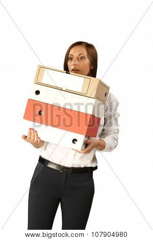 Secretary Woman With A Large Stack Of Folders Isolated On White Background
