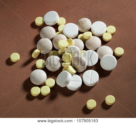 Stack Of Tablets On Brown Background