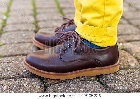 Fashion brown shoes on kid's feet