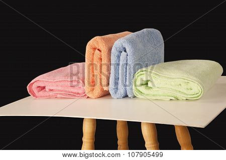 Colorful Terry Towels Isolated On Dark Background