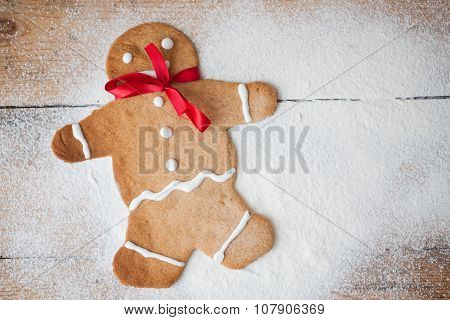 Gingerbread man on wood, suitable snow and winter