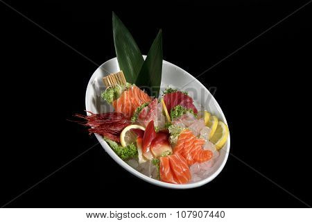 Round Plate Of Sushi And Sashimi On Black