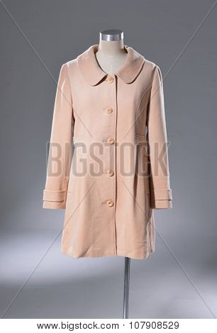 female coat dress on dummy