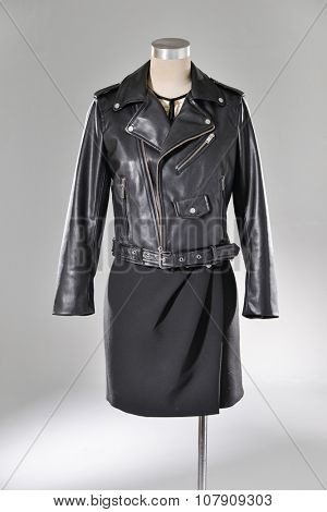 female black jacket on dummy-light background