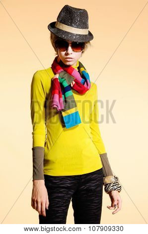fashion model in modern clothes with sunglasses, hat posing