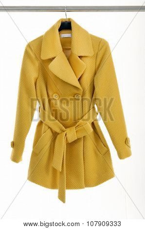Female yellow coat clothing on hanging