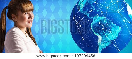 Young woman stands near big earth