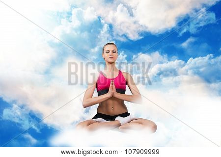 Woman sitting in lotus position on the clouds