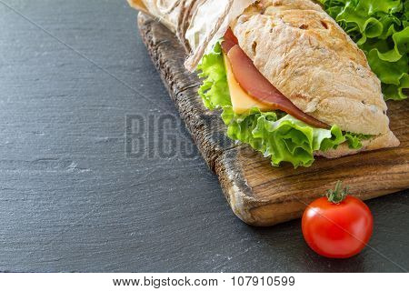 Sandwich with cheese abd ham, salad and tomatoes