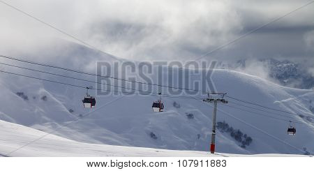 Panoramic View On Gondola Lifts And Off-piste Slope In Mist