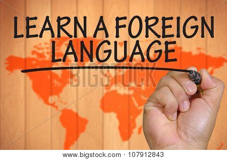 Hand Writing Learn A Foreign Language Over Blur World Background