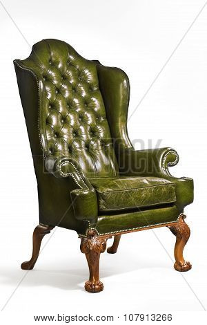 Antique Green Leather Wing Chair Carved Legs Isolated