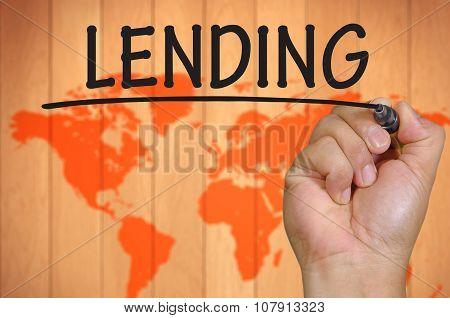 Hand Writing Lending  Over Blur World Background