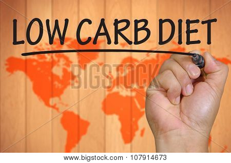 Hand Writing Low Carb Diet Over Blur World Background