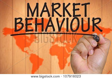 Hand Writing Market Behaviour Over Blur World Background