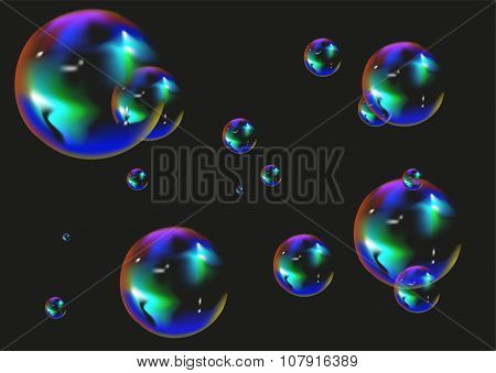 Multi colored soap bubbles on black background