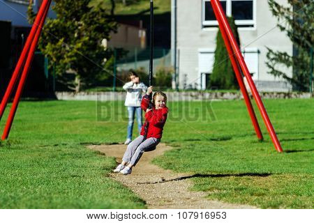 Two Sisters Playing In The Playground, Sunny Day