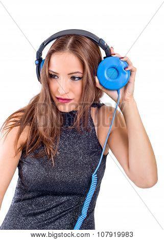 Woman playing music on pickup mixer