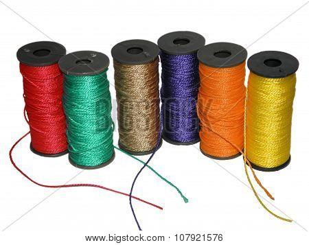 Bright multi-colored threads in spools