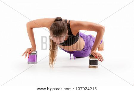 athletic woman working out on cans BCAA and Amino Isolated on white background