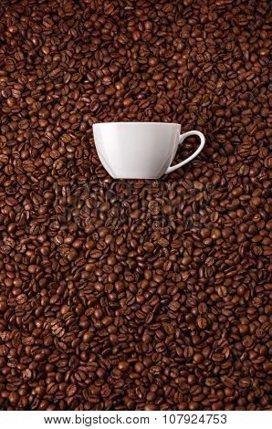 White mug at coffee beans background