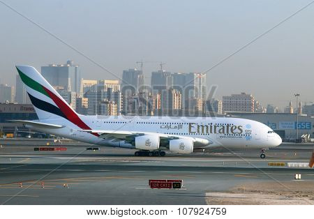 DUBAI, UAE - NOVEMBER 10, 2015: The Airbus A380 Emirates take off on Dubai International Airport. Plane for 615 passengers is biggest airliner on the world.