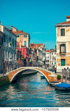Bridge over channel among houses in Venice Italy. Illustration