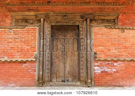 KATHMANDU, NEPAL - APRIL 2014 : Intricate and beautiful hand crafted wooden doorframe and wall decoration in Kathmandu Durbar Square, Nepal on 12 April 2014.