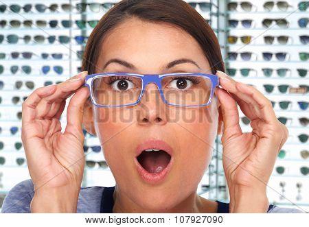 Beautiful young lady wearing eyeglasses close-up.