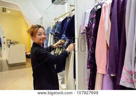 HONG KONG - NOVEMBER 02, 2015: seller work in boutique in New Town Plaza. New Town Plaza is a shopping mall in the town centre of Sha Tin in Hong Kong. Developed by Sun Hung Kai Properties