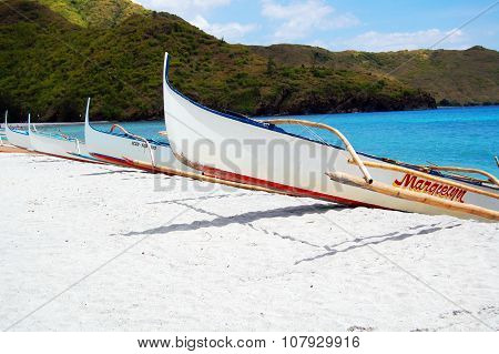 White Fishing Boats in Anawangin Cove, Zambales, Philippines
