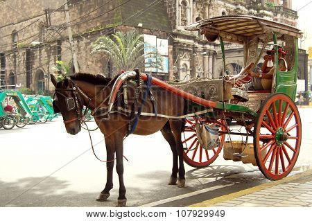 Kalesa (horse drawn calash) in Binondo, Manila, Philippines