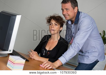 Business People Working Together On Laptop