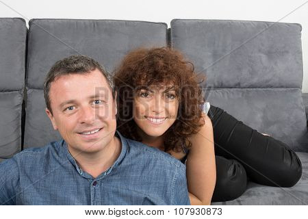 Bored Couple Sitting On The Couch
