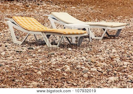 Vacant Chaise Lounge On The Beach.dangerous Vacation.