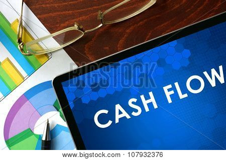 Tablet with cash flow on a table.