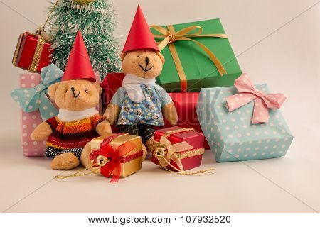 Merry Christmas, decoration with a couple Lovely bear, a gift,  christmas tree, and ribbon