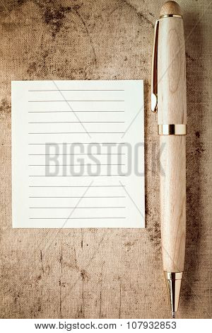 Wooden Pen And Empty Paper Note For Your Text