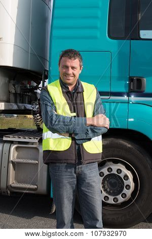 Confident Man Standing In Front Of Truck
