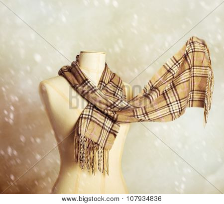 Vintage tailors dummy with woollen winter scarf - blur in scarf to give motion effect