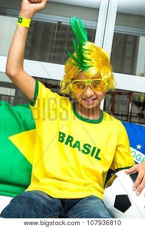 Brazilian boy celebrates at home