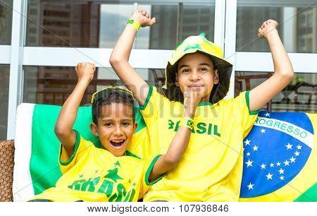 Brazilian boys celebrate at home