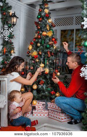 Family Decorates A Christmas Tree