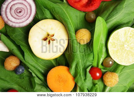 Cute bouquet of sorrel decorated with vegetables and fruits background