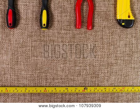 set of tools on a brown background