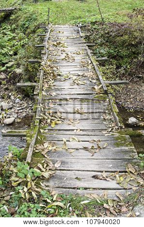 Old Wooden Bridge Without Railings