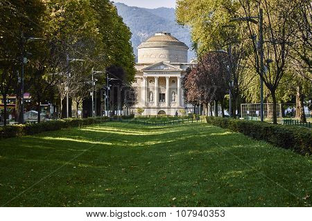 Public Garden Near The Lake In The City Of Como, In The Background The Temple Dedicated To The Inven